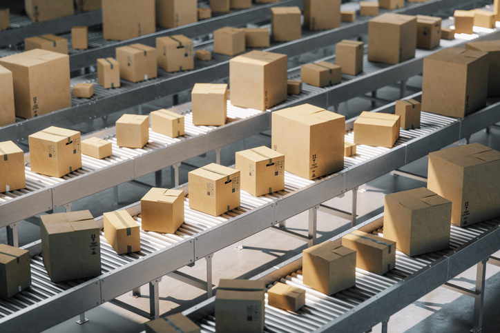 boxes on conveyor rollers in an Amazon warehouse